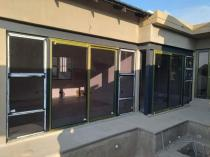 Out with old fashioned sliding doors and in with new High Perfomance sliding doors Lombardy Aluminium Doors 3 _small