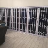 Looking for a PHYSICAL SECURITY BARRIER in Gauteng? We supply and install   ✅security gates,  ✅burglar bars,  ✅fencing,  ✅roller shutters,  ✅retractab Kempton Park CBD Expandable Security Gates _small