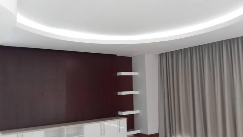 Large circular bulkhead with internal light trough, with curtain pelmet/drapery pocket
