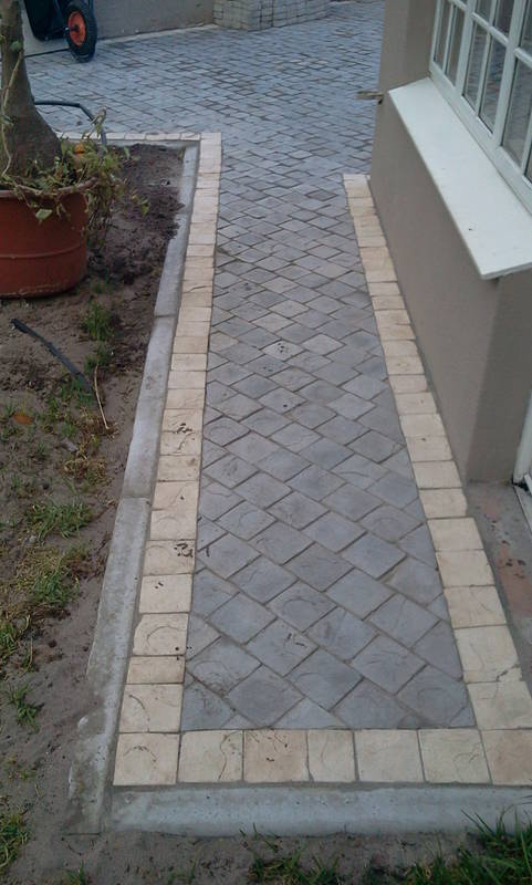 CEMENT COBBLES CHARCOAL WITH SANDSTONE BORDER