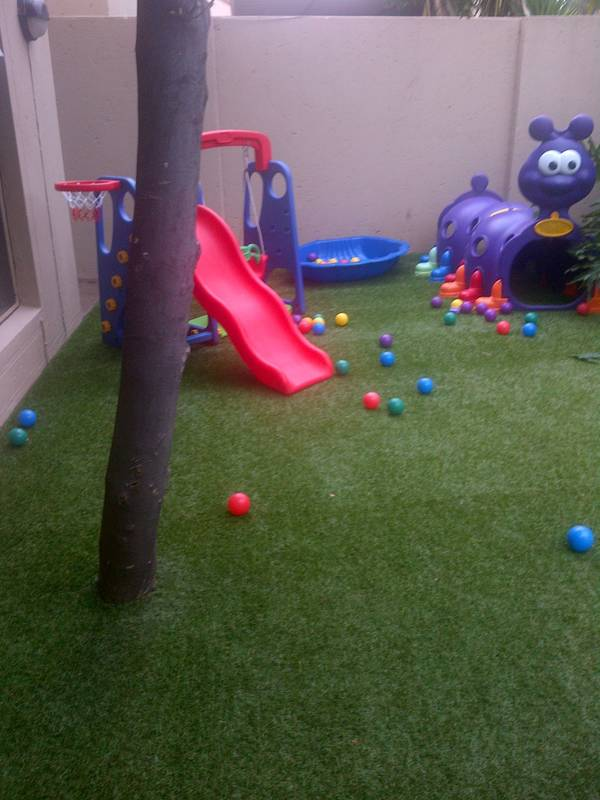 Small play area in a private garden.