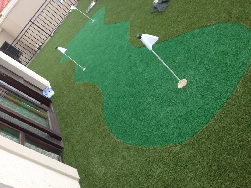A patio turned into a putting green.