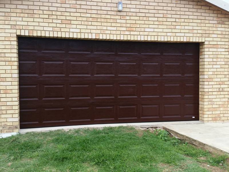Double Teak Brown Fibreglass Sectional Door.