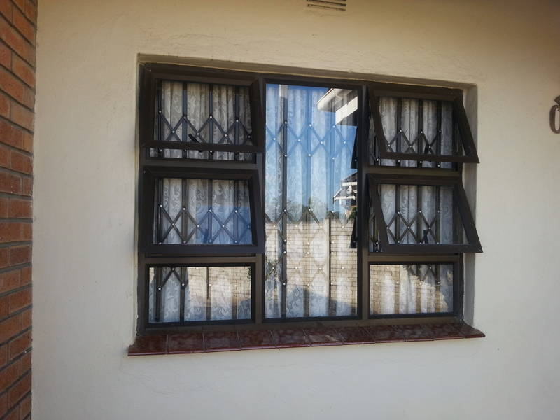 Aluminium windows with trellidor style steel burgular bars