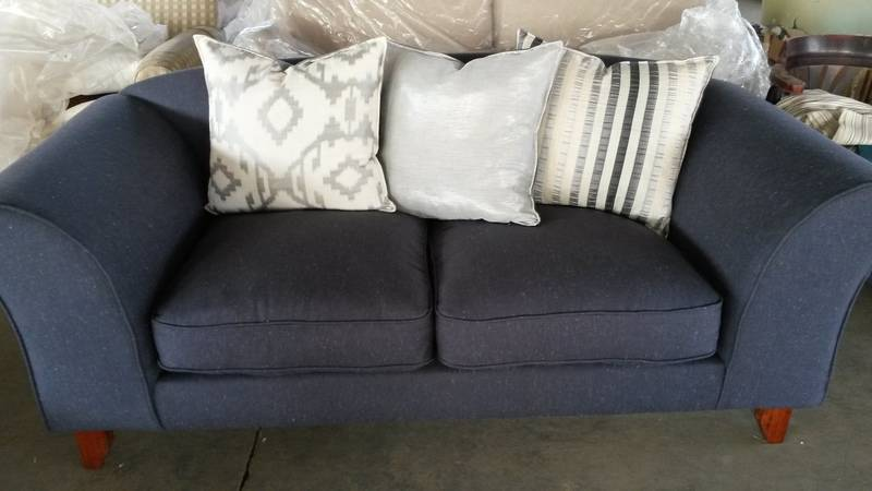 Denim Sofa with silver cushions for accent.