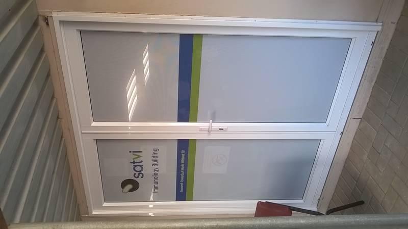 Custom made aluminium doors with signage also designed for SATVI