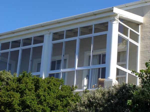 Balcony Ensclosure with Sliding Windows