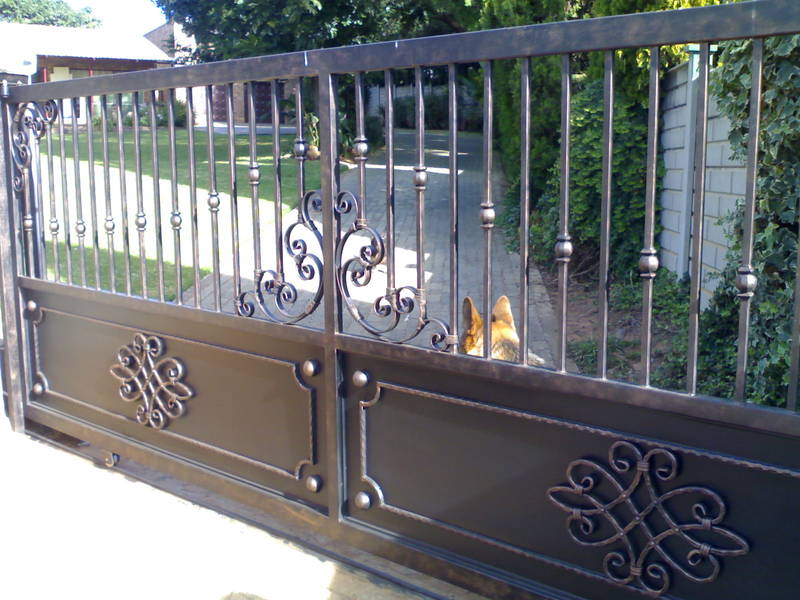 A combination of wrought iron and metal sheeting