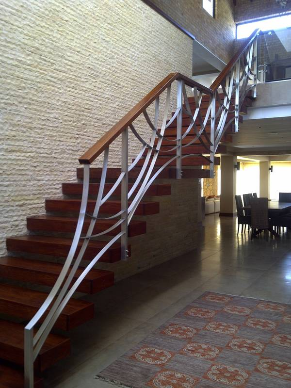Cantilevered staircase with designer Stainless steel balustrade