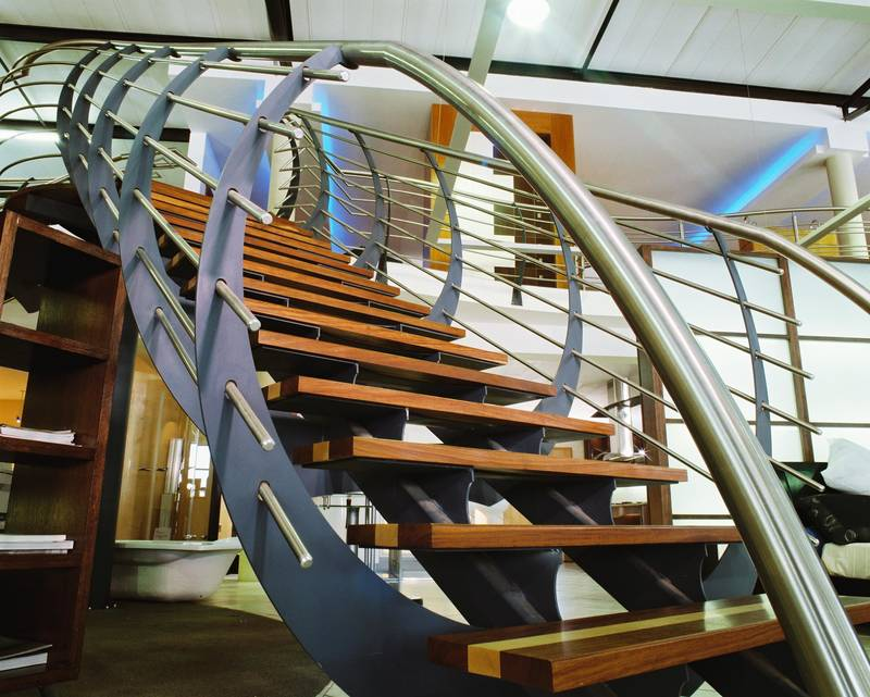 Double stringer showroom staircase with blade design balustrade
