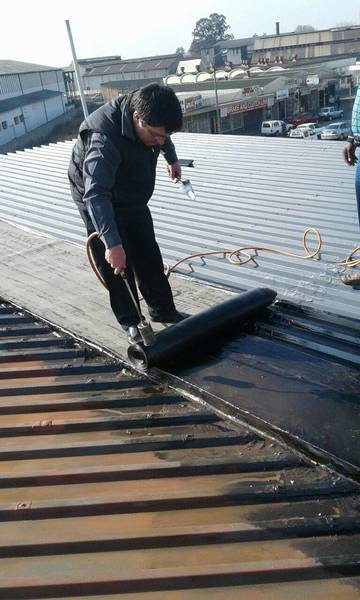 FREE 1000L slimline water tank with any roofing or gutters done by us Germiston CBD Gutter Contractors & Services 2