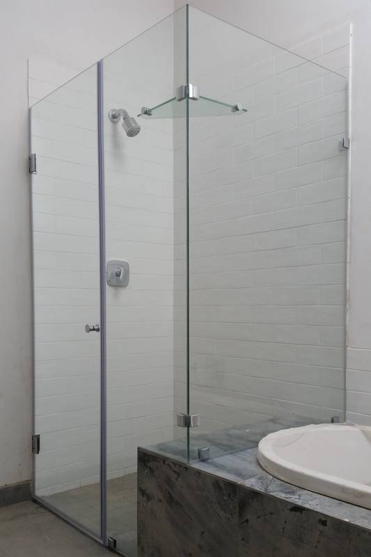 Hinged door with cut out over bath panels