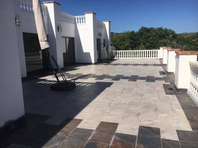 Large scale levelling and specialist tile-work