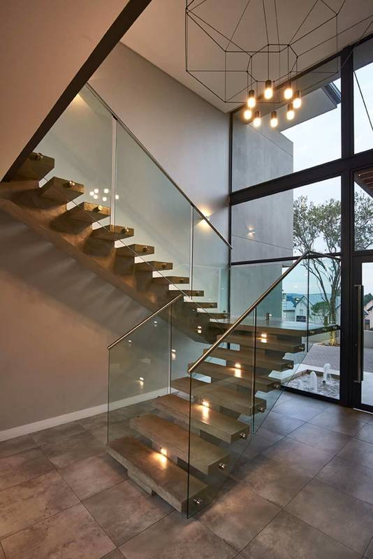 Inso Frameless specialises in the custom design, manufacture and installation of Frameless Showers, Frameless Stacking Doors and Frameless Doors and Partitions.  All the frameless glass is processed in our facility in KyaSand Randburg.