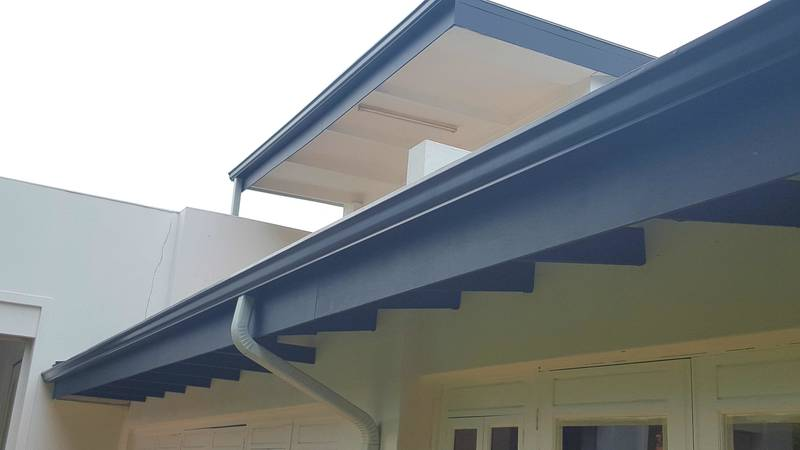 Black Industrial gutters with White pipes in Pretoria